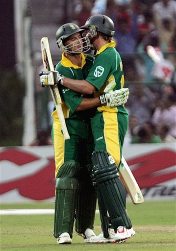 South African batsman Herschelle Gibbs, left, is hugged by teammate Abraham Devilliers after he scored a half-century in the second semi-final of the ICC Trophy cricket tournament in Jaipur