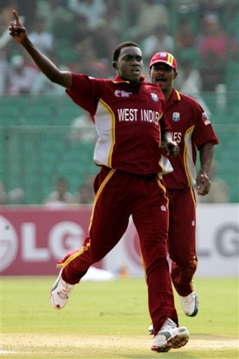 West Indies cricket bowler Jerome Taylor, left, celebrates after taking the wicket of South Africa's Graeme Smith, not in photograph, in Jaipur