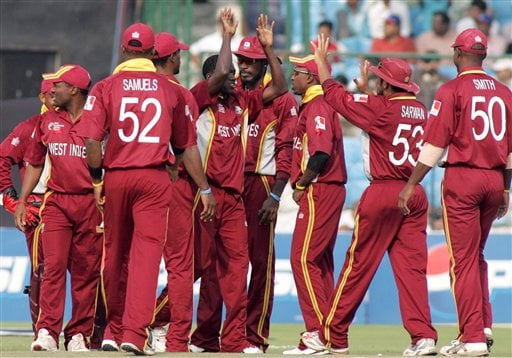 West Indies team members congratulate Jerome Taylor, fourth left, after he bowled out South African cricket captain Graeme Smith, unseen, during the ICC Champions Trophy cricket tournament match in Jaipur