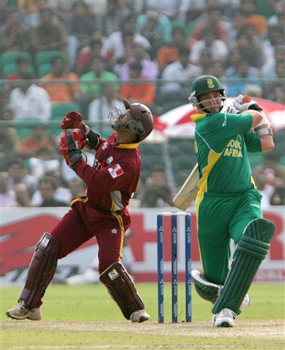 West Indian wicket keeper Carlton Baugh, left, looks in the direction of the thirdman after South African batsman Jacques Kallis miscued a shot in the second semi-final of the ICC Trophy cricket tournament in Jaipur