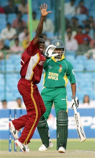 West Indies' Jerome Taylor appeals unsuccessfully for the wicket of South African Loots Bosman, right, during the ICC Champions Trophy cricket tournament match in Jaipur
