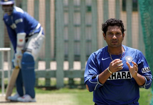 India's cricket player Sachin Tendulkar, right, walks way as is teammate Anil Kumble, left, looks on during the team practice in Benoni, South Africa.
