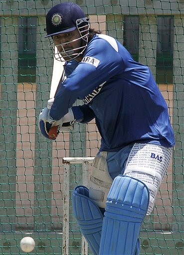 India's cricket player Mahendra Dhoni, bats during the net practice in Benoni, South Africa.