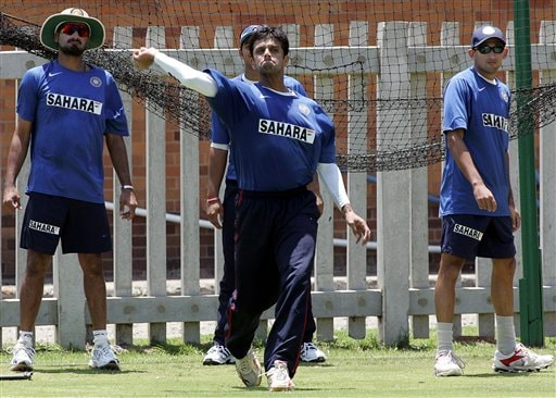 India's cricket captain Rahul Dravid, center, throws the ball as teammates Harbhajan Singh, left, and Ajit Agarkar, right, look on during their practice in Benoni, South Africa.