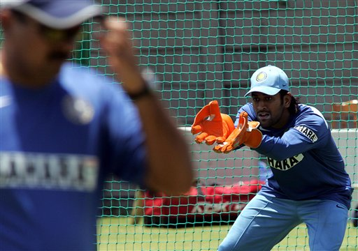 India's wicketkeeper Mahendra Dhoni, looks on during the fielding practice in Benoni, South Africa.