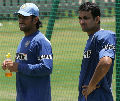 India's cricket player Mahendra Dhoni, left, with teammate Zaheer Khan, right, during the net practice in Benoni, South Africa.