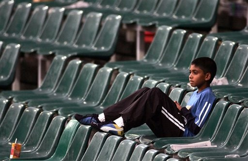 A young boy looks on as the rain delays the start of the 1st match one-day series India v South Africa in Johannesburg, South Africa, Sunday, Nov. 19, 2006. The first one-day international match was officially called off, because of persistent rain.