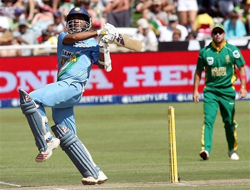 India's Dinesh Mongia hits a delivery during their third one-day international against South Africa in Cape Town, South Africa, Sunday, Nov 26, 2006.