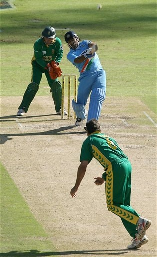 India's Mahendra Singh Dhoni hits a six during the third one-day cricket international in Cape Town, South Africa, Sunday, Nov 26, 2006.