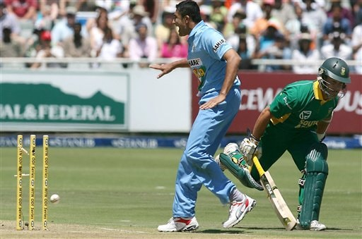 India's Anil Kumble runs out South Africa's Mark Boucher, right, during their third one-day international cricket match in Cape Town, South Africa, Sunday, Nov 26, 2006.