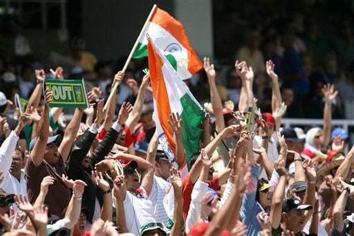 Indian cricket fans celebrate a wicket during the third one-day international against South Africa in Cape Town, South Africa, Sunday, Nov 26, 2006.