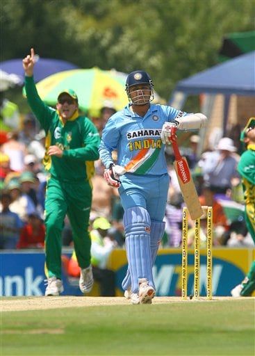 Indian Captain Virenda Sehwag walks back to the pavillion while South African Captain Graeme Smith celebrates the fall of the first wicket of the final ODI at Supersport Park, Centurion on Sunday.