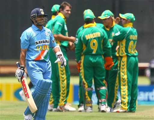 Indian batsman Sachin Tendulkar leaves the field while the South African team celebrates the taking of his wicket during the final ODI at Supersport Park, Centurion on Sunday.