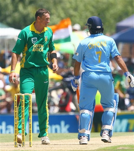 Indian batsman Mahendra Singh Dhoni converses with South African bowler Andre Nel during the final ODI at Supersport Park, Centurion on Sunday.