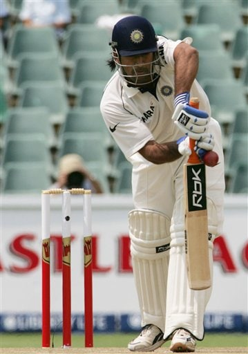 India's batsman Mahendra Singh Dhoni, bats during the second day of the first cricket test match against South Africa at the Wanderers stadium in Johannesburg, South Africa.