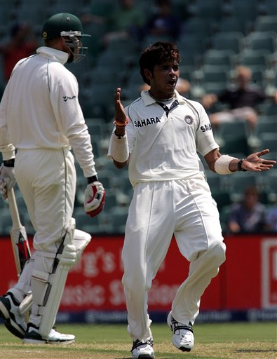 India's bowler Shanthakumaran Sreesanth, right, celebrates after bowling out South Africa's batsman Shaun Pollock, left, for a 5 runs during their second innings on the second day of the 1st cricket test match against South Africa's their second innings at the Wanderers stadium in Johannesburg, South Africa.