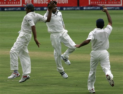 India's bowler Shanthakumaran Sreesanth, center, celebrates with teammate Anil Kumble, left, and Dinesh Karthik, right, after dismissing South Africa's batsman Hashim Amla, unseen, for a duck during the second day of the first cricket Test match against South Africa at the Wanderers stadium in Johannesburg, South Africa.