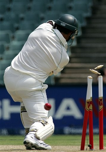 South Africa's batsman Mark Boucher, is bowled out by India's bowler Shanthakumaran Sreesanth, unseen, for 5 runs during their second innings on the second day of the first cricket Test match against India at the Wanderers stadium in Johannesburg, South Africa.