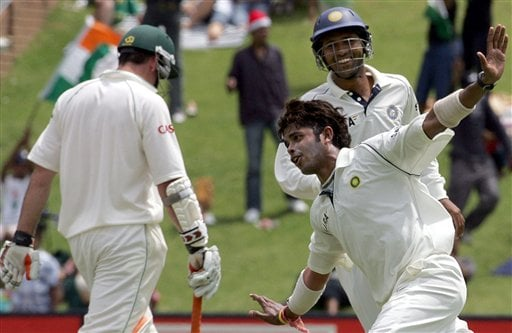 India's bowler Shanthakumaran Sreesanth, center, with teammate Wasim Jaffer, right, celebrates after dismissing South Africa's batsman Graeme Smith, left, for 10 runs during their second innings on the third day of the 1st cricket test match against South Africa at the Wanderers stadium in Johannesburg, South Africa.