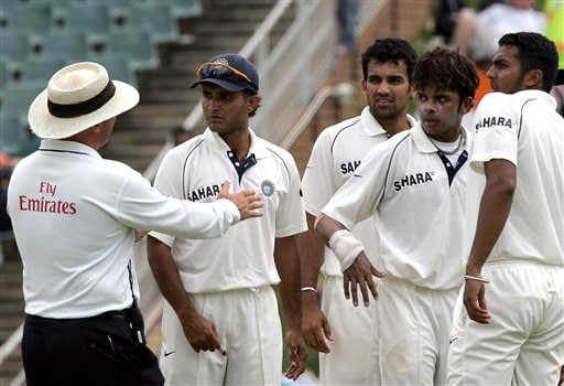 Umpire Mark Benson of England, left, has a word with India's bowler Shanthakumaran Sreesanth, second from right, and teammates after taunting South Africa's batsman Hashim Amla, unseen, on his dismissing during the third day of the 1st cricket test match between South Africa and India at the Wanderers stadium in Johannesburg, South Africa.