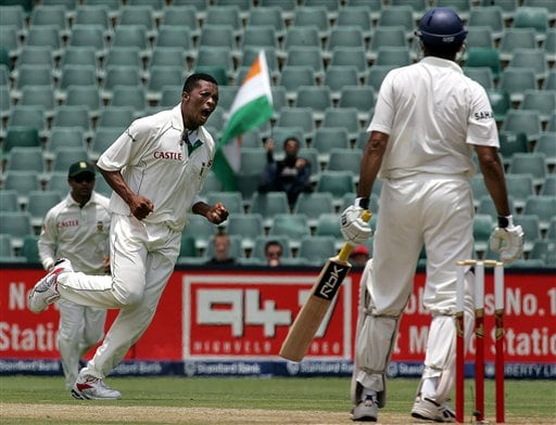 South Africa's bowler Makhaya Ntini, left, celebrates after dismissing India's batsman VVS Laxman, right, for 73 runs during the third day of the 1st cricket test match against India's second innings at the Wanderers stadium in Johannesburg, South Africa.