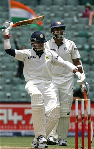 India's batsman Shanthakumaran Sreesanth, front, waves his bat to the crowd as he hit 6 runs whilst teammate VRV Singh, back, looks on during their second innings on the third day of the 1st cricket test match against South Africa at the Wanderers stadium in Johannesburg, South Africa.