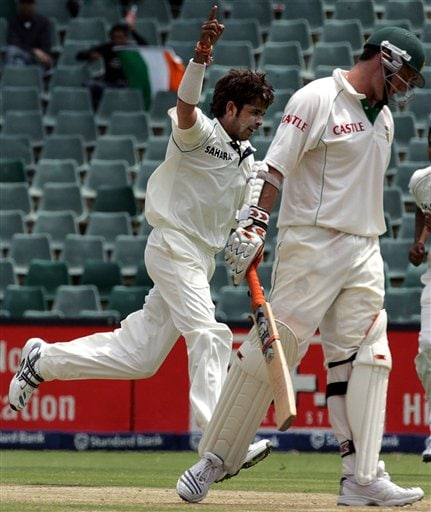 India's bowler Shanthakumaran Sreesanth, left, celebrates after dismissing South Africa's batsman Graeme Smith, right, for 10 runs during their second innings on the third day of the 1st cricket test match against South Africa at the Wanderers stadium in Johannesburg, South Africa.