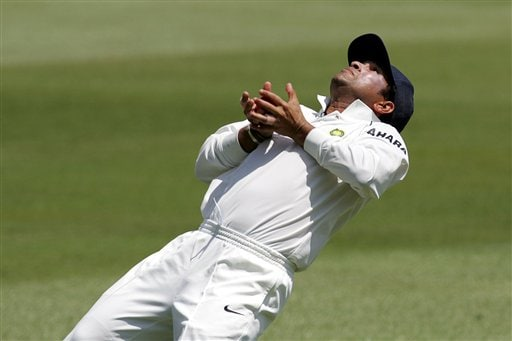 India's Sachin Tendulkar, makes a catch to dismiss South Africa's batsman Graeme Smith, unseen, for 5 runs on the first day of the 2nd Cricket Test match against South Africa at Kingsmead stadium in Durban.