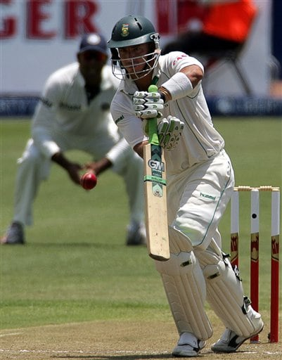 South Africa's batsman Herschelle Gibbs, right, plays a shot as India's fielder VVS Laxman, left, looks on during the first day of the 2nd Cricket Test match against India at Kingsmead stadium in Durban.
