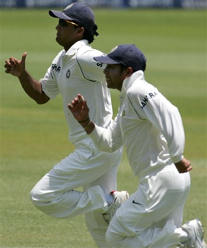 India's Sourav Ganguly, left, with teammate Sachin Tendulkar, right, chases the ball on the first day of the 2nd Cricket Test match against South Africa at Kingsmead stadium in Durban.