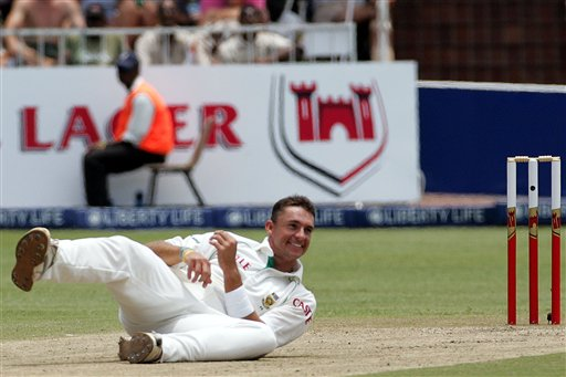 South Africa's bowler Andre Nel, falls on the ground after his bowling spell on the second day of the 2nd Cricket Test match against India at Kingsmead stadium in Durban, South Africa, Wednesday.
