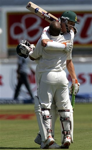 South Africa's batsman Morne Morkel, back, congratulate teammate Ashwell Prince, front, for scoring a century on the second day of the 2nd Cricket Test match against India at Kingsmead stadium in Durban, South Africa, Wednesday.