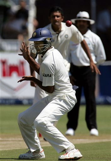 India's fielder Wasim Jaffer, front, attempts to field off bowling of teammate bowler Anil Kumble, back, as umpire Asad Rauf of Pakistan, right, looks on during the second day of the 2nd Cricket Test match against South Africa at Kingsmead stadium in Durban, South Africa, Wednesday.