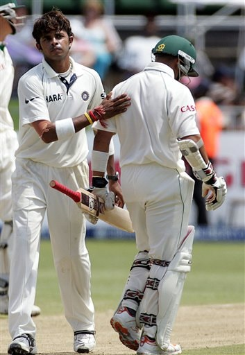 India's bowler Shanthakumaran Sreesanth, left, honors South Africa's batsman Ashwell Prince, right, after dismissing him for 121 runs on the second day of the 2nd Cricket Test match against South Africa at Kingsmead stadium in Durban, South Africa, Wednesday.