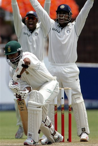 India's wicketkeeper Mahendra Singh, right, appeals with teammate VVS Laxman, left, successfully for a LBW to dismiss South Africa's batsman Makhaya Ntini, center, for 16 runs on during the second day of the 2nd Cricket Test match against South Africa at Kingsmead stadium in Durban, South Africa, Wednesday.