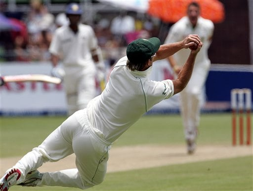 South Africa's fielder AB de Villiers, makes a catch to dismiss India's batsman Virender Sehwag, unseen, for a duck on the second day of the 2nd Cricket Test match against India at Kingsmead stadium in Durban, South Africa, Wednesday.