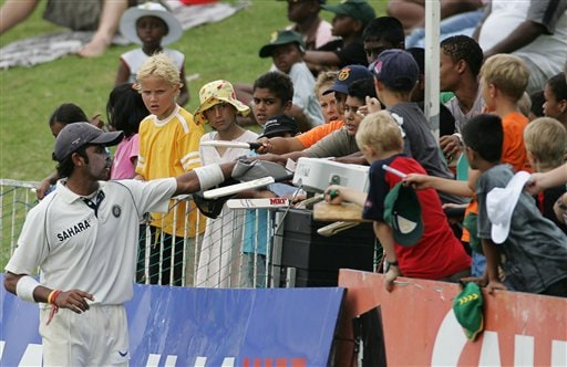 India's Sri Sreesanth, signs autographs on the third day of the 2nd Cricket Test match against South Africa second innings at Kingsmead stadium in Durban, South Africa, Thursday.