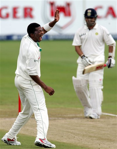 South Africa's bowler Makhaya Ntini, left, appeals successfully for a LBW to dismiss India's batsman Sachin Tendulkar, right, for 63 runs on the third day of the 2nd Cricket Test match against India at Kingsmead stadium in Durban, South Africa, Thursday.