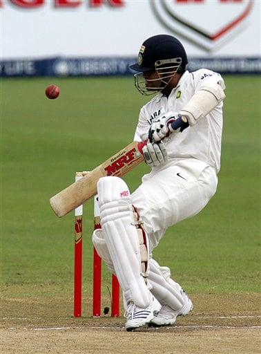 India's batsman Sachin Tendulkar, takes evasive action against a bouncer on the third day of the 2nd Cricket Test match against South Africa at Kingsmead stadium in Durban, South Africa, Thursday.