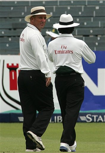Umpire Mark Benson of England, left, leaves the field with Asad Rauf of Pakistan, right, into the fourth over on the third day of the 2nd Cricket Test between South Africa and India at Kingsmead stadium in Durban, South Africa, Thursday, Dec. 28, 2006. Mark Benson was taken to hospital for tests after suffering heart palpitations while standing in the second Test between South Africa and India at Kingsmead Thursday. Benson, 48, left the field one ball into the fourth over of the third day and was replaced by Ian Howell of South Africa.