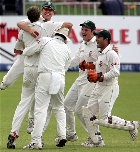 South Africa's players celebrates the dismissal of India's batsman Mahendra Singh Dhoni, unseen, for 34 runs on the third day of the 2nd Cricket Test match against India at Kingsmead stadium in Durban, South Africa, Thursday.