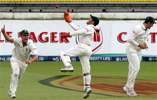 South Africa's Ab de Villiers, left, with teammates wicketkeeper Mark Boucher, center, and captain Graeme Smith, right, celebrates the dismissal of India's batsman Anil Kumble, unseen, for a duck on the third day of the 2nd Cricket Test match against India at Kingsmead stadium in Durban, South Africa, Thursday.