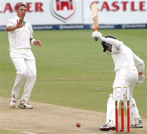 South Africa's bowler Andre Nel, left, reacts after bowling against India's batsman Shanthakumaran Sreesanth, right, on the third day of the 2nd cricket Test match at Kingsmead stadium in Durban, South Africa, Thursday.