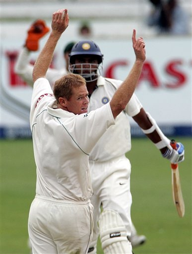 South Africa's bowler Shaun Pollock, front, appeals successfully for a LBW to dismiss India's batsman VRV Singh, back, for 6 runs on the third day of the 2nd Cricket Test match against India at Kingsmead stadium in Durban, South Africa, Thursday.