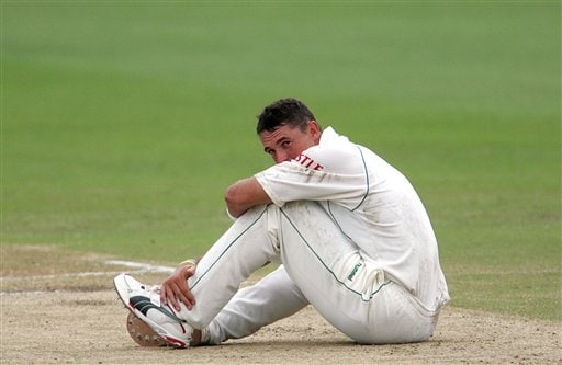 South Africa's bowler Andre Nel looks on after falling on the ground during his bowling spell on the fourth day of the 2nd cricket Test match against India's second innings at Kingsmead stadium in Durban, South Africa, Friday.