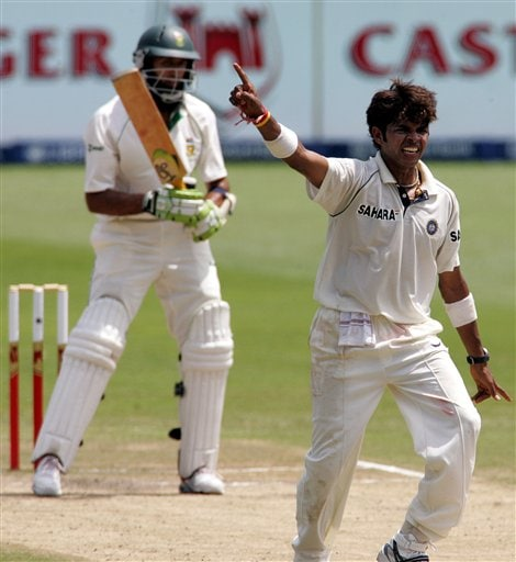 India's bowler Shanthakumaran Sreesanth, right, appeals successfully for a LBW to dismiss South Africa's batsman Hashim Amla, left, for a duck on the fourth day of the 2nd Cricket Test match against South Africa at Kingsmead stadium in Durban, South Africa, Friday.
