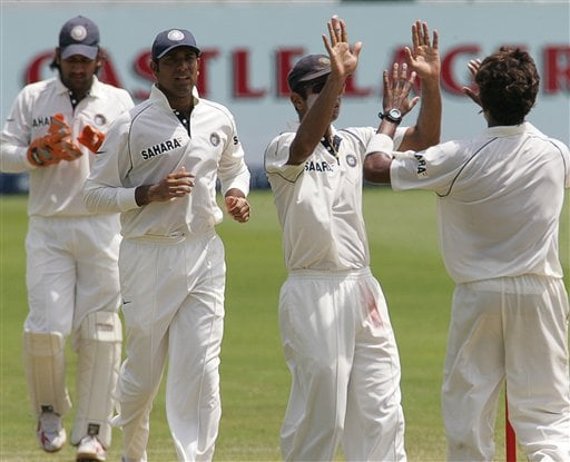 India's players wicketkeeper Mahendra Singh Dhoni, left, with VVS Laxman, and captain Rahul Dravid, second from right, celebrate with teammate bowler Shanthakumaran Sreesanth, right, for dismissing South Africa's batsman Hashim Amla, unseen, for a duck on the fourth day of the 2nd Cricket Test match against South Africa at Kingsmead stadium in Durban, South Africa, Friday.