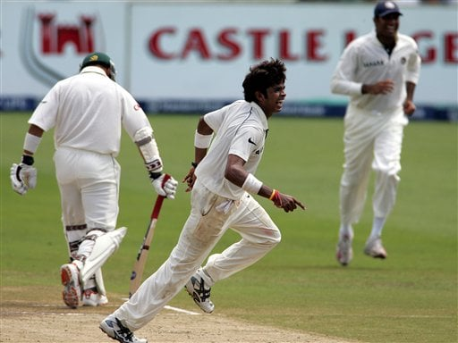 India's bowler Shanthakumaran Sreesanth, center, celebrate with teammate VVS Laxman, right, after dismissing South Africa's batsman Ashwell Prince, left, for a duck on the fourth day of the 2nd Cricket Test match against South Africa at Kingsmead stadium in Durban, South Africa, Friday.