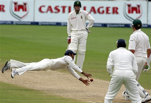 India's fielder Dinesh Karthik, left, with teammate VVS Laxman, second right, attempts to field off a shot from South Africa's batsman Morne Morkel, right, as teammate Shaun Pollock, second left, looks on, on the fourth day of the 2nd cricket Test match at Kingsmead stadium in Durban, South Africa, Friday.