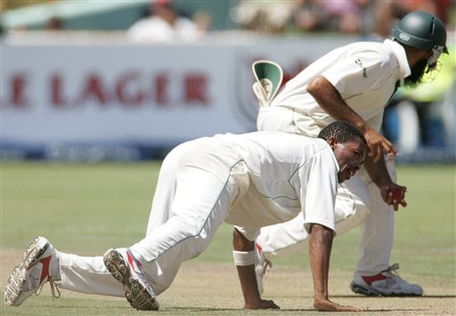 South Africa's bowler Makhaya Ntini, left, looks on as teammate Hashim Amla, right, fields off his bowling on the first day of the 3rd and final Test match against India at Newlands stadium in Cape Town, South Africa, Tuesday.